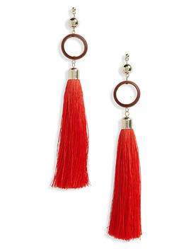 wood-circle-tassel-earrings by topshop
