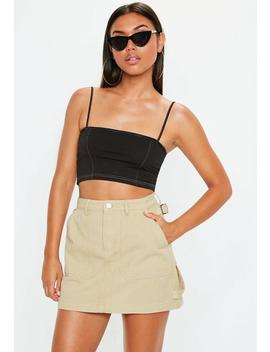 beige-denim-side-strap-mini-skirt by missguided