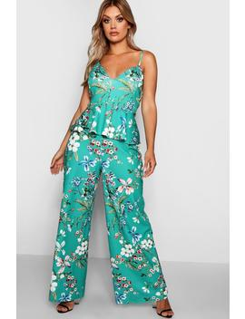 plus-strappy-floral-peplum-jumpsuit by boohoo