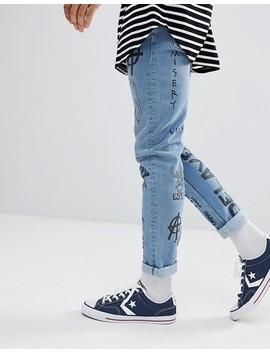 asos-design-–-skinny-jeans-in-verwaschenem-mittelblau-mit-grunge-prints by asos