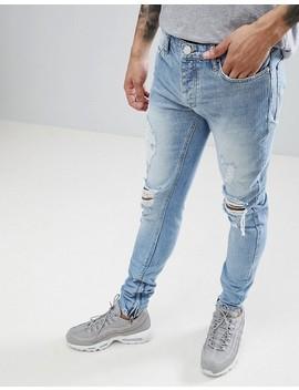criminal-damage-–-skinny-jeans-in-verwaschenem-hellblau-mit-distressed-design by criminal-damage