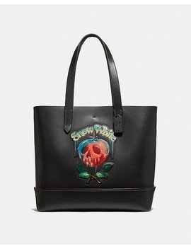 disney-x-coach-gotham-tote-with-poison-apple-graphic by coach