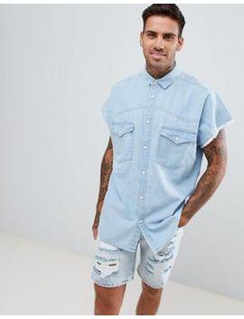 asos-design-oversized-raw-edge-bleach-wash-denim-shirt by asos-design