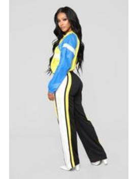 nayeli-flare-pants---black_yellow by fashion-nova