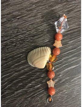 small-orange-seashell-beaded-bracelet by etsy