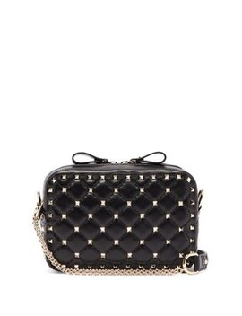 rockstud-spike-quilted-leather-cross-body-bag by valentino