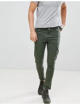 asos-design-super-skinny-jeans-in-green-with-cargo-pockets by asos-design