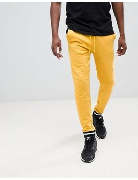 asos-design-skinny-joggers-in-yellow-with-contrast-tipping by asos-design