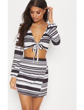 black-multi-stripe-wrap-front-mini-skirt by prettylittlething