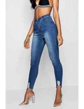 Ultra Distressed Hem Skinny Jeans by Boohoo