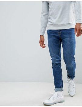 Jack & Jones Slim Taper Jeans In Mid Blue Denim by Jack & Jones