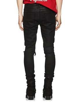 Broken Coated Skinny Jeans by Amiri