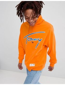 Tommy Jeans Signature Capsule Logo Front Hoodie Relaxed Fit In Orange by Tommy Jeans