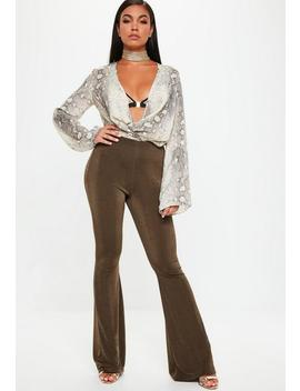 Gold Slinky Kickflare Pants by Missguided