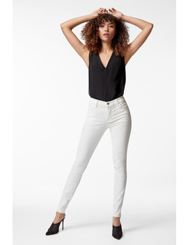 620 Mid Rise Super Skinny In Coated Bubble by J Brand