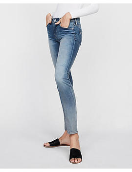 Mid Rise Light Wash Stretch Skinny Jeans by Express