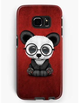 Cute Panda Bear Cub With Eye Glasses On Deep Red by Jeff Bartels