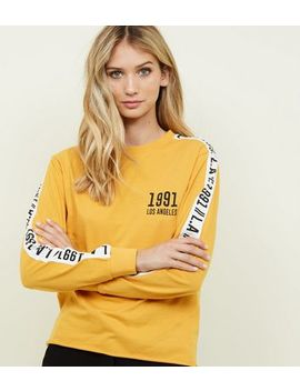 Mustard 1991 Printed Long Sleeve T Shirt by New Look