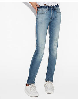 Mid Rise Ripped Stretch+ Performance Skinny Jeans by Express