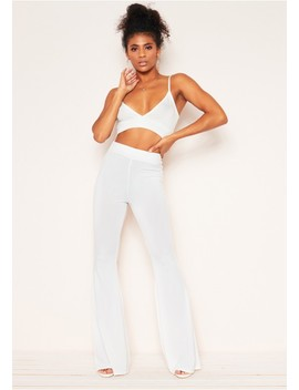 Georgina White Ribbed Skinny Flare Trousers by Missy Empire