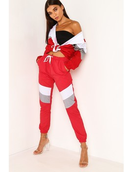 Red Colour Block Shell Cuff Joggers by Lasula