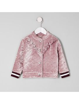 Mini Girls Pink Frill Velvet Bomber Jacket by River Island