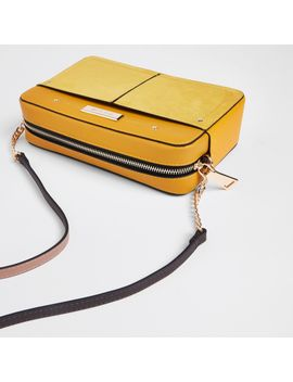 Yellow Tassel Boxy Cross Body Bag                                    Yellow Pocket Front Slouch Bag by River Island