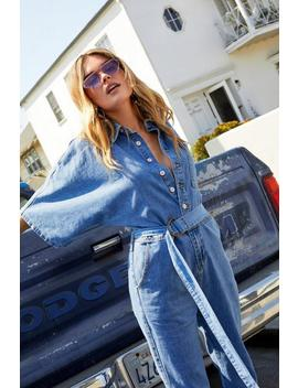 The Complete Package Denim Jumpsuit by Nasty Gal