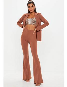 Rust Crepe Flared Trousers by Missguided
