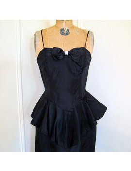 Vintage 1980s Black Party Dress With Rhinestone Bow And Sassy Peplum   Size Small To Extra Small, Xs/S, 32 Inch Bust by Fashionrerun