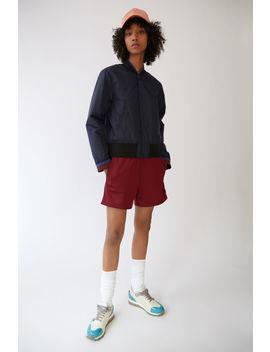 track-shorts-burgundy by acne-studios