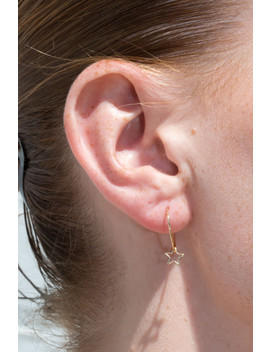 Gold Hollow Star Charm Hoop Earrings by Brandy Melville