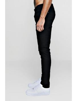 Black Stretch Skinny Jeans With Ripped Knees by Boohoo