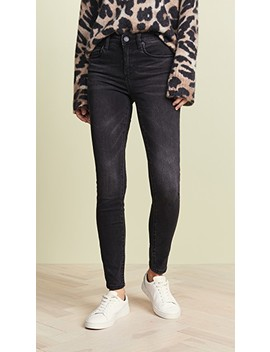 The Bond Mid Rise Skinny Jeans by Blank Denim