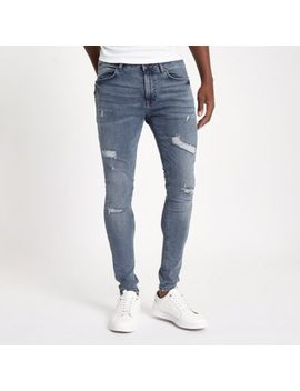 Blue Ollie Spray On Distressed Skinny Jeans by River Island