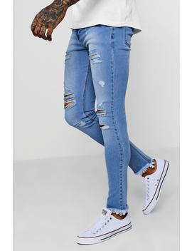 Super Skinny Jeans With Distressed Hem by Boohoo
