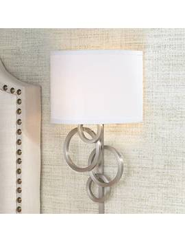 Possini Euro Design Circles Plug In Wall Sconce by Lamps Plus