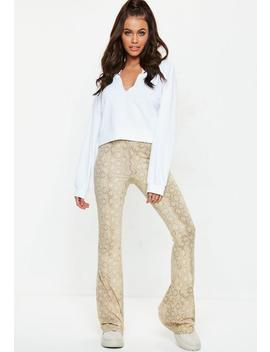 Yellow Snake Flared Trousers by Missguided