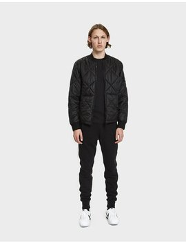 Garment Dyed Quilted Micro Yarn Down Bomber Jacket In Black by Stone Island
