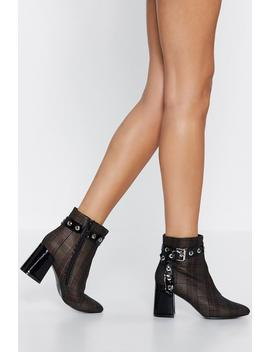 All Checked Out Flare Heel Boot by Nasty Gal