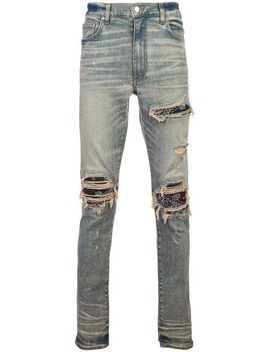 Ripped Layered Skinny Jeans by Amiri