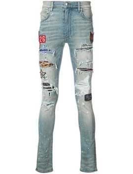 Distressed Skinny Jeans With Patch Appliqués by Amiri