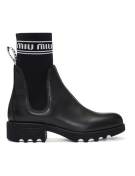 Black Leather & Sock Boots by Miu Miu