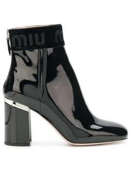 Varnished Logo Boots by Miu Miu