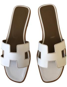 White Classic Oran Box Leather H Flats Slides Sandals by Hermès