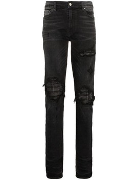 Slim Fit Distressed Cotton And Leather Jeans by Amiri
