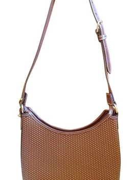 Cabriolet Pierced Brown Leather Hobo Bag by Dooney & Bourke