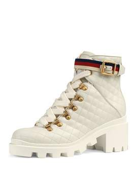 Quilted Leather Combat Boots by Gucci
