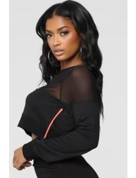 Keep Your Eyes On Me Sweatshirt   Black by Fashion Nova
