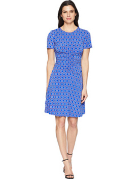 Short Sleeve Jersey Dress With Ruching And Asymmetrical Hem by Donna Morgan